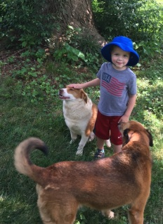 Boys and dogs -- better then bacon and eggs ... almost. Me and Maggie with Nick.