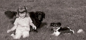 That would be me ... with Blackie and her pup Tippy. Tippy was our first family dog, 1961 or so.